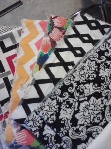 I spent a long time selecting fabrics that I thought reflected the personality of the children. K is a classic beauty. J loves superheroes. O is girly, and a little anal retentive. She'd respond to the precision of a nice, geometric chevron.