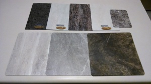 Our laminate samples! The official start to everything. The bottom center sample is the clear winner, in my mind.