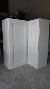In order to space the doors correctly so that they would open without interference, Honest Husband placed a single cover panel between the two cabinets to give them clearance.