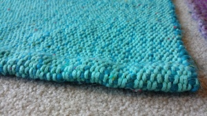 I am in love with the turquoise cotton on the warp (vertical strands). It turned out bright and beautiful.
