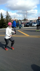My husband took this as I approached the finish line. I'm waving a bending down towards my daughter.